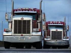 tractor trailers at company-sponsored cdl training