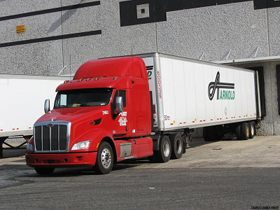 Arnold Transportation red peterbuilt hiring new drivers.